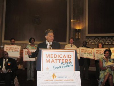 Sen. Franken speaks out in support of Caring Across Generations. Photo by Jobs with Justice.