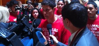 Felipe Matos of Presente.org talks to reporters after leading Dreamers in chanting during Obama's speech.