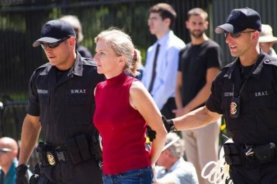 Daphne Wysham gets arrested at the White House while protesting the Keystone XL pipeline. Photo by Shadia Fayne Wood