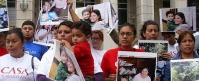 Roxana Santos and other immigrant women demand justice.
