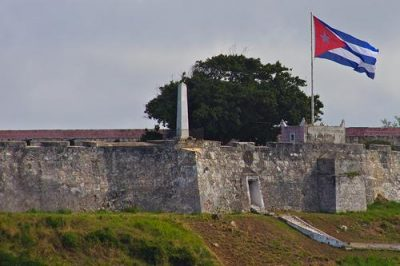 A Cuban flag flies over Havana Harbor. Photo by Ed Yourdon.