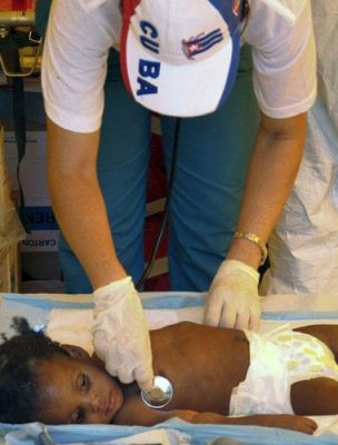 A Cuban doctor treats a Haitian child sick with Cholera. Acts of good will are key to Cuba's diplomatic styrategy. Photo by The Independent.