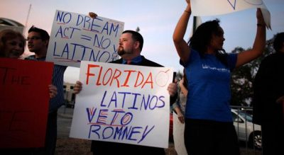 Anti-Romney protesters in Florida (Charles Dharapak / AP)