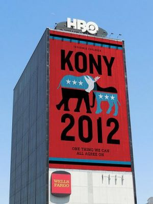 A Kony 2012 billboard is displayed above a Wells Fargo advertisement at the HBO headquarters. Photo by Avakian/Flickr.