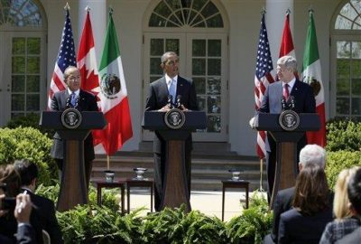 arack Obama, Felipe Calderon and Stephen Harper. AP photo.