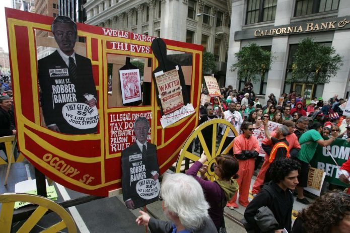 Protesters brought a makeshift wagon to the Wells Fargo protest. Photo by Mike Koozmin (SF Examiner)