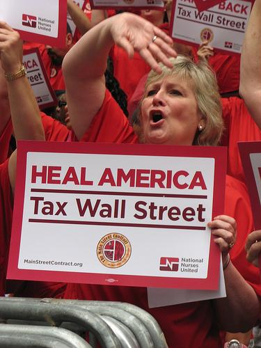 Nurses rally for a financial transactions tax. Photo by Robin Hood Tax campaign.