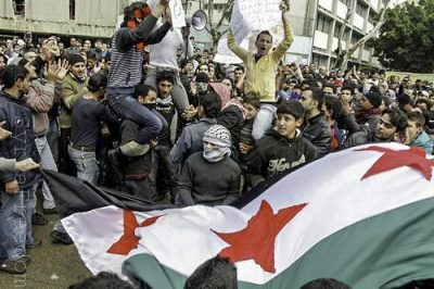 Syrian protesters living in Lebanon shout slogans against Syria's President Bashar al Assad during a demonstration after Friday prayers in Beirut March 16, 2012. Photo by Freedom House.