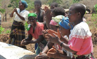 Women of Njolo, Malawi, celebrate a new irrigation project to help them adapt to climate change. Photo credit: CIDSE - Catholic Development Agencies.