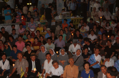 7/27 rally for peace in Seoul. Kang Jeong-Koo is seated in the bottom row, third from the right.
