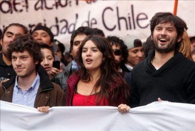 Student leaders Noam Titelman, Camila Vallejo and Boris Gabriel participate in a demonstration in downtown Santiago