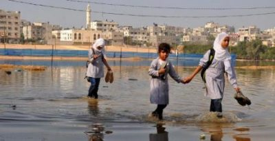 Gaza schoolgirls wade through sewage
