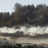 Israel Gaza burning buildings