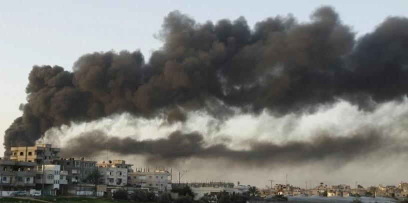 Israel Gaza burning buildings
