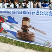 Banner of Salvadorans protest