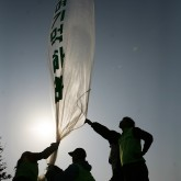 Korean activists launch balloons containing anti-Kim Jong-Il propaganda leaflets.