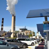 Smoke stack next to a solar cell