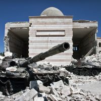 Destroyed tanks in front of a mosque in Azaz, Syria.