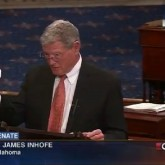 Sen. Inhofe 'disproving' climate change by dropping a snowball on the Senate floor.