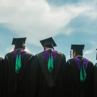 college graduates looking onto horizon
