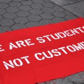 Student debt strike sign