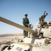 "Image: ""Peshmerga on a T-55-Tank outside Kirkuk in Iraq."" by Boris Niehaus  CC BY-SA 3.0 via Wikimedia Commons)"