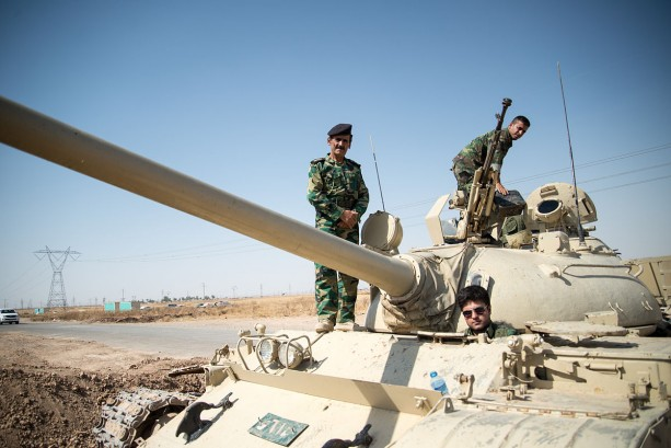 "Image: ""Peshmerga on a T-55-Tank outside Kirkuk in Iraq."" by Boris Niehaus  CC BY-SA 3.0 via Wikimedia Commons)"