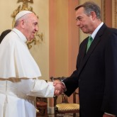 Speaker John Boehner shakes the Pope's hand