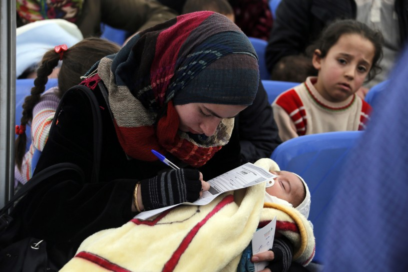 Refugee mother holds baby