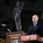Putin stands at podium in Korea