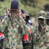 colombia-eln-militant-in-uniform