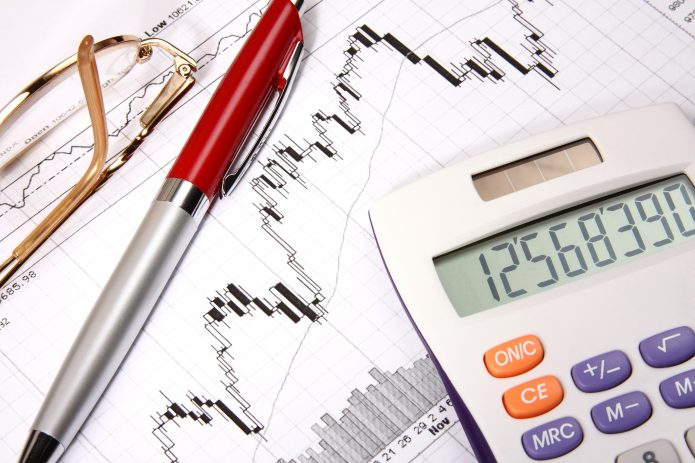 finances-charts-red-pen-calculator