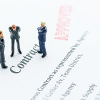 contract-agreement-binding-business-businessmen