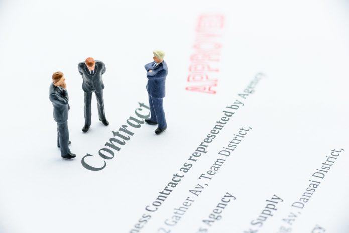 contract-agreement-binding-business-businessmen